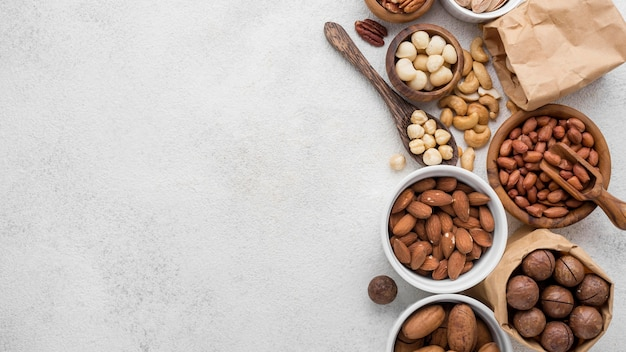 Different kinds of nuts in bowls copy space