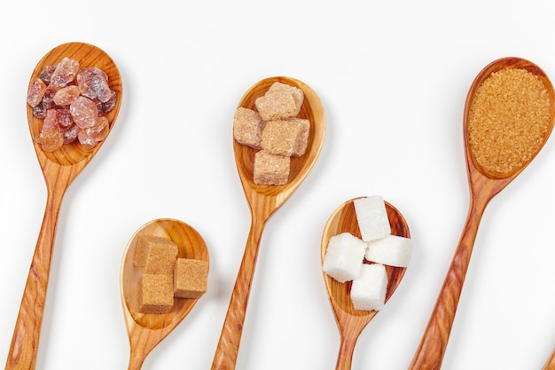 Different kinds of sugar in the spoons close up