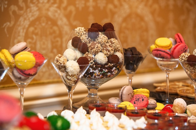 Different kinds of sweets and candies at the buffet for a party, catering