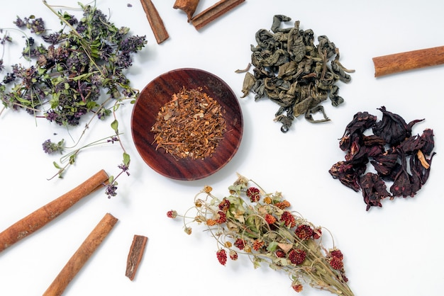Different kinds of teas on white surface.