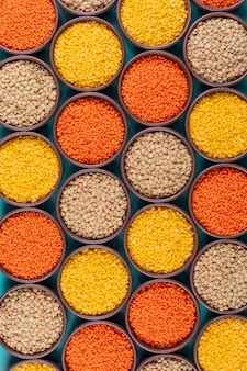 Different lentils in a bowls flat lay
