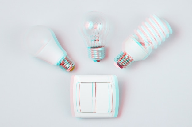 Different light bulb, switch on gray background. minimalism electro consumer concept. glitch effect