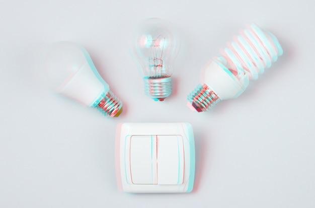 Различные лампочки, переключатель на сером фоне. потребительская концепция минимализма. эффект сбоя