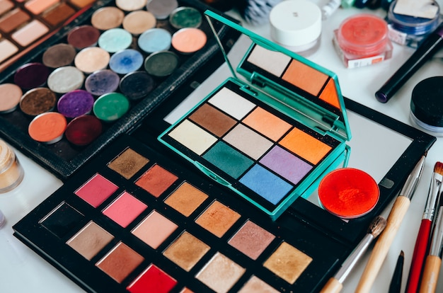 Different makeup products on table