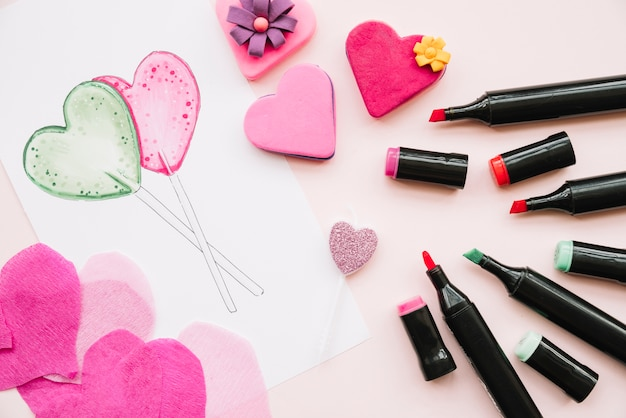 Different markers near ornament and painted hearts