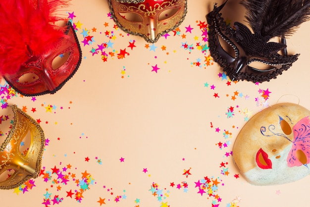 Different masks and stars on table