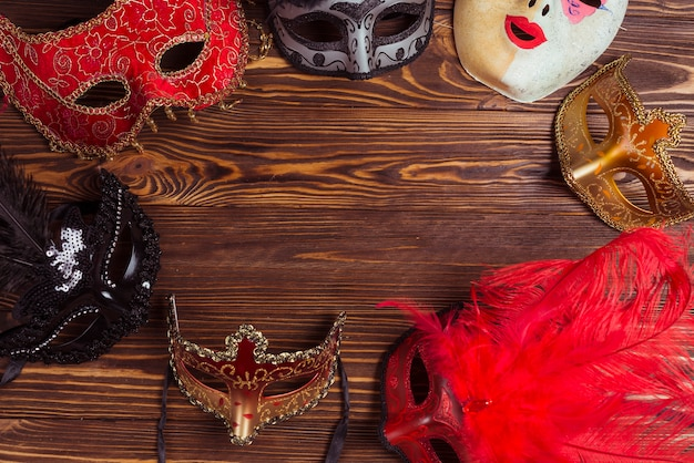 Different masks on wooden table