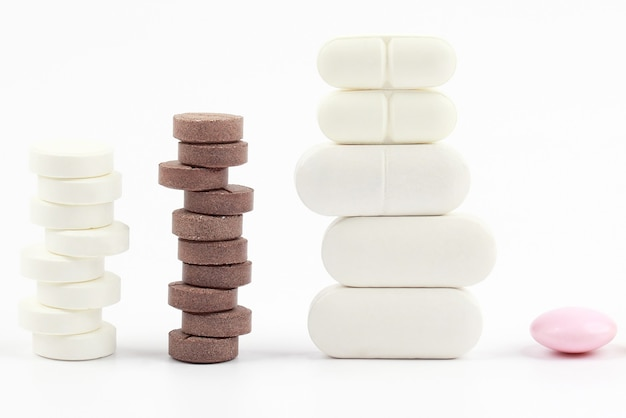 Different medicinal pills on white background.  pharmacology, medicine and treatment of diseases