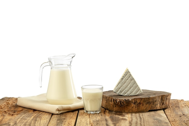 Different milk products, cheese, cream, milk on wooden table and white wall. healthy eating and lifestyle, organic natural nutrition, diet. delicious food and drinks.