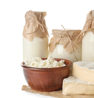 Different milk products on white surface