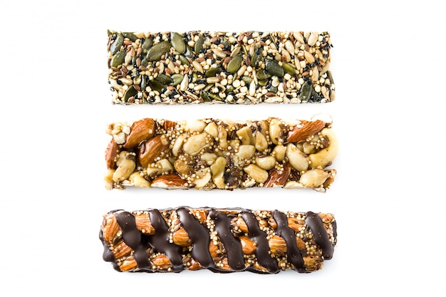 Different muesli bars isolated on white