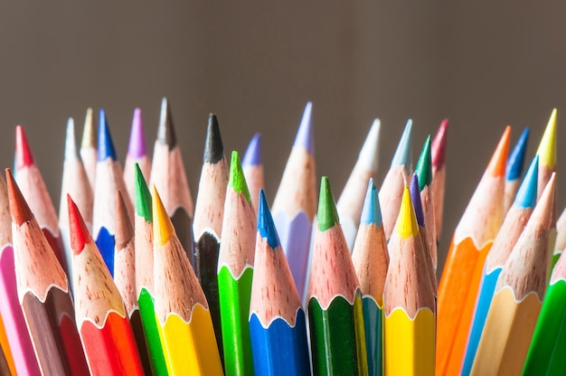 Different multicolor pencil, education and art tool concept supply