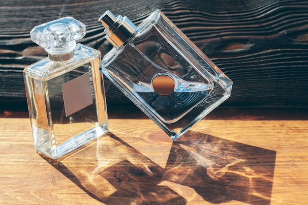 Different perfume bottles on the wooden