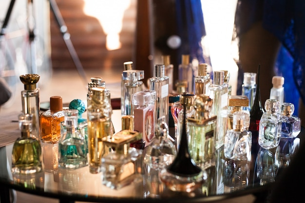 Different perfume on the table, perfume for women and men