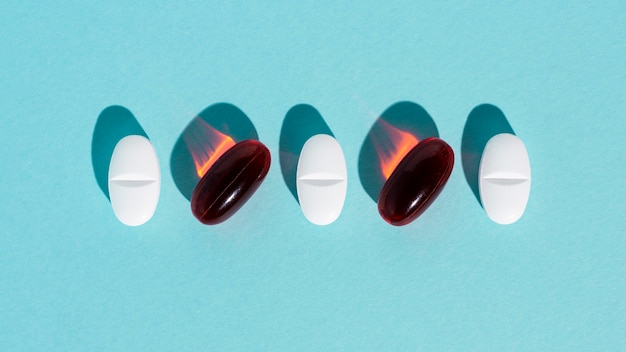 Different pills on blue background