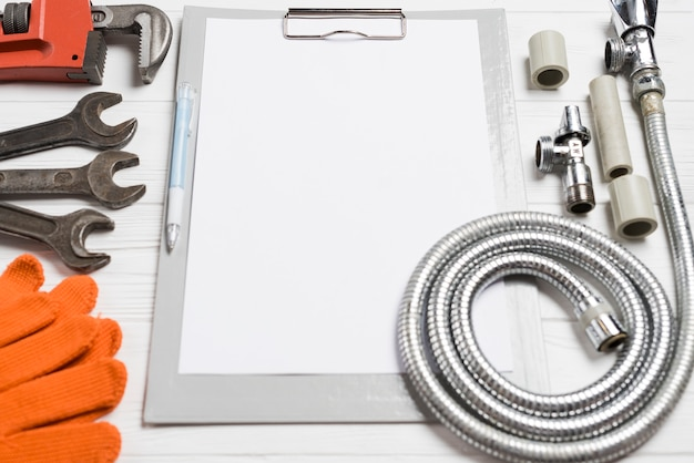 Different plumber tools and paper