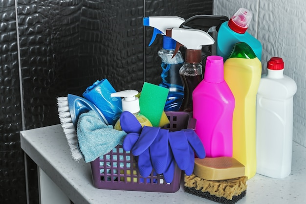 Different products and items for cleaning on the floor in the toilet room