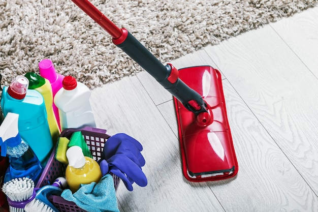 Different products and items for cleaning on the floor