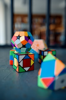 Different puzzle cubes on the table, nobody. toy for brain and logical mind training, creative game, solving of complex problems