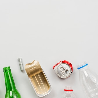 Different recyclable waste on white background