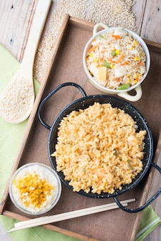 Different rice dishes (paella with vegetables, tomato and rice pudding)