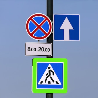 Different road signs on a pole