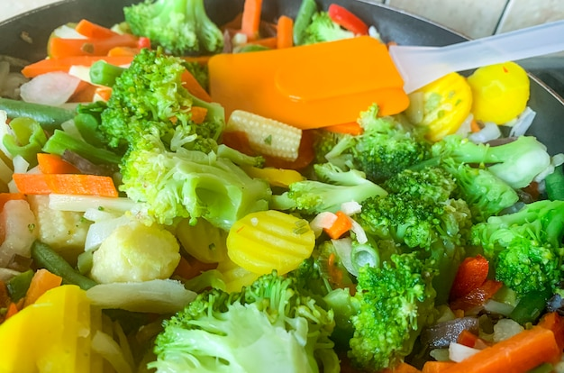 Different seasonal vegetables are fried in pan. studio photo.