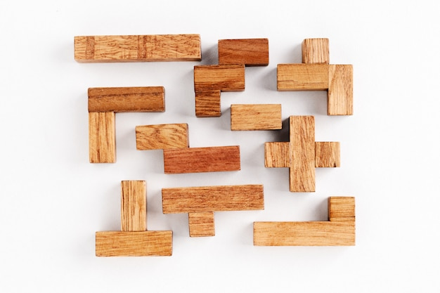 Different shapes wooden blocks on white background