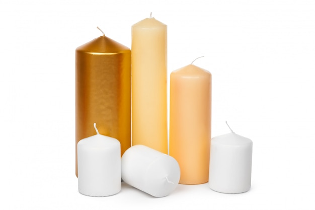 Different sized candles on a white