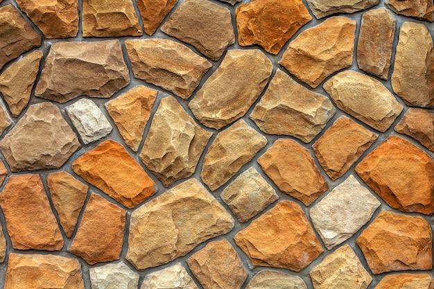さまざまなサイズの砂岩。石の壁のパターンの背景