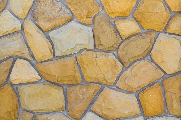 異なるサイズの砂岩。石の壁のパターンの背景