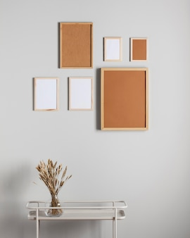 Different sizes photo frames on wall