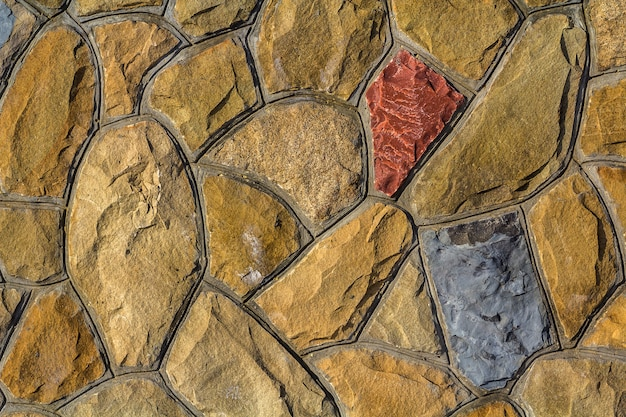 Different sizes of sand stones. stone wall pattern background