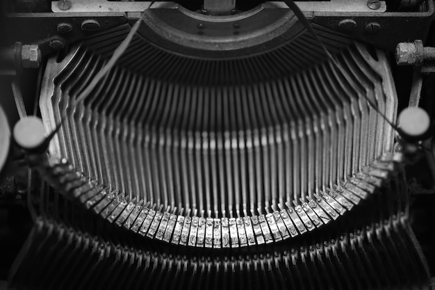 Different small metal elements of an old typewriter macro