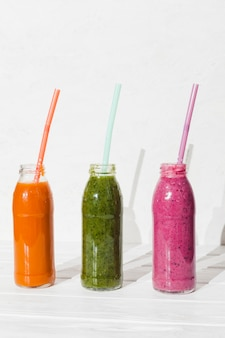 Different smoothies in bottles