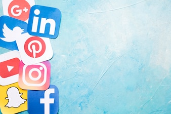 Different social media icons on blue painted wall