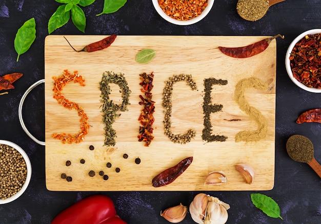 Different spices on dark