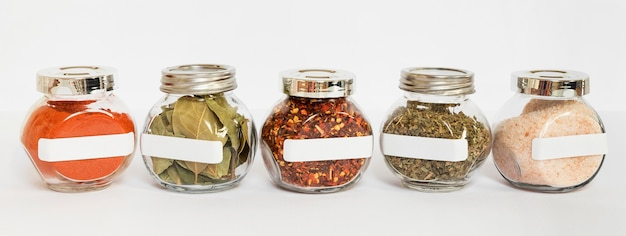 Different spices in jars composition