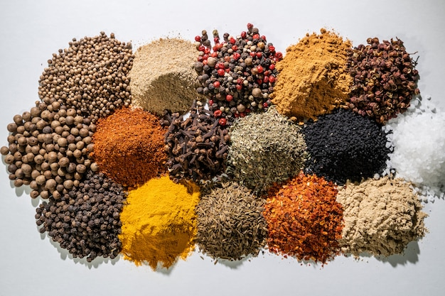 Different spices set on white background