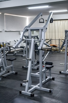 Different sport equipment in modern gym closeup