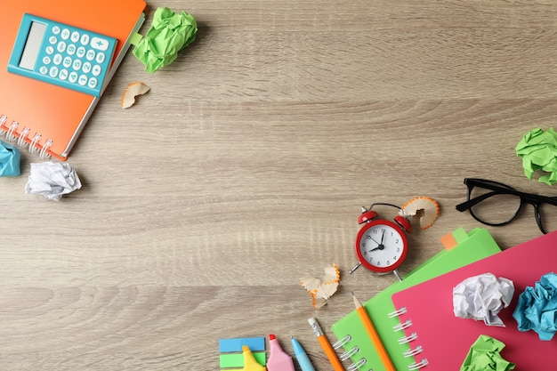 Different stationary on wooden table, top view and space for text