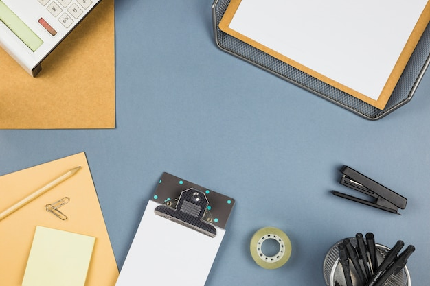 Different stationery on grey table