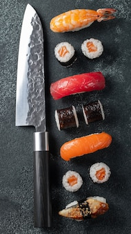 Different sushi with japanese knife. flat lay.