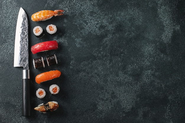 Different sushi with japanese knife.