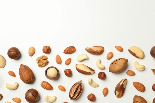 Different tasty nuts on white