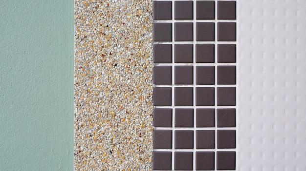 Различные текстуры плитки, цемента и гравия на стене