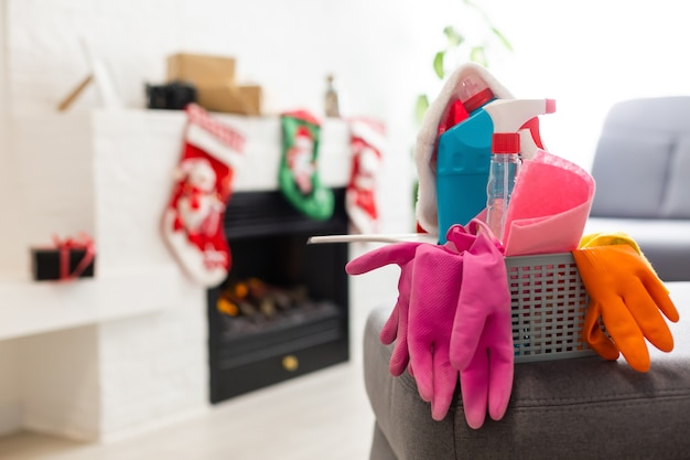Different tools for cleaning in kitchen over christmas background