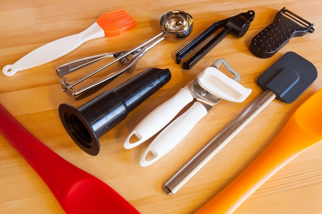 Different tools for cooking food on a wooden