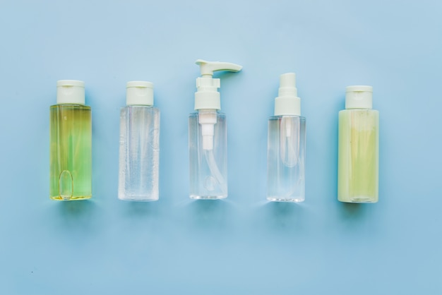 Different type of aloevera spray bottles on blue background