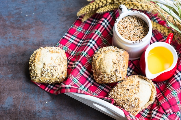 Different type of bread and ingredients on rustic background